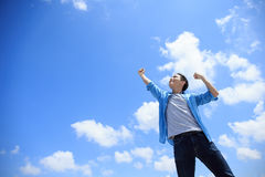 Carefree man feel happy. Carefree and free man raised hands and looking to a sky, asian Stock Photography