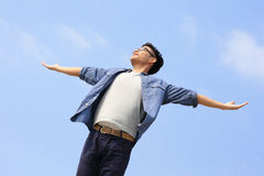 Carefree man. Carefree and free man raised hands and enjoy nature, asian Stock Photos