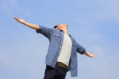 Carefree man. Carefree and free man raised hands and looking to a sky, asian Royalty Free Stock Photos