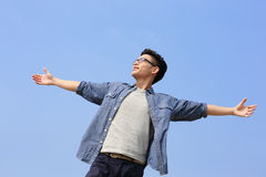 Carefree man. Carefree and free man raised hands and looking to a sky, asian Stock Photography