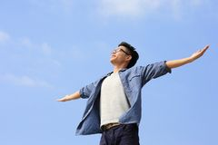 Carefree man. Carefree and free man raised hands and looking to a sky, asian Royalty Free Stock Photo