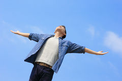 Carefree man. Carefree and free man raised hands and looking to a sky, asian Royalty Free Stock Images
