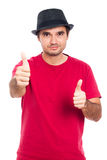 Carefree man gesturing thumbs up. Happy casual carefree man gesturing thumbs up, isolated on white background Royalty Free Stock Photos