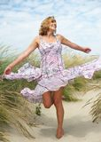 Carefree middle aged woman dancing outdoors Royalty Free Stock Image