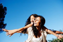 Carefree mother and child playing in the sun Stock Photo