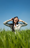 Carefree music girl on green field Stock Photo