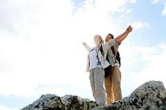 Carefree outdoor lifestyle. Successful and triumphant women hikers are happy on top of the mountain royalty free stock photography