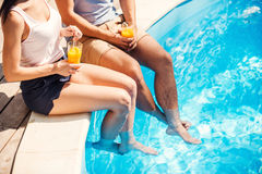 Carefree relax at the pool. Royalty Free Stock Image