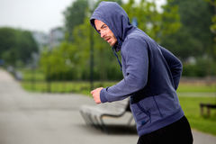 Carefree runner from the side outdoors Stock Photography