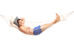 Carefree shirtless man lying on a hammock Royalty Free Stock Photos