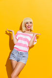 Carefree smiling blonde spread her hands Stock Photography