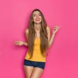 Carefree Smiling Girl In Orange Shirt Royalty Free Stock Image