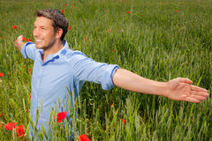Carefree success man. Happy carefree peaceful male enjoying good weather in field Royalty Free Stock Photography