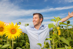 Carefree success man. Happy carefree peaceful male enjoying good weather in field Royalty Free Stock Images