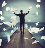 Carefree successful businessman. Carefree successful man throws in air documents Royalty Free Stock Images