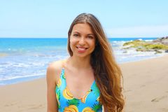 Carefree swimsuit woman enjoying  beach. Beautiful relaxing model with long hair on summer travel vacation in light blue swimsuit. In tropical destination royalty free stock photography