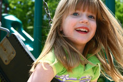 Carefree on a swing. Four year old child being carefree on a swing Royalty Free Stock Images