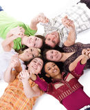 Carefree teenagers. Group of carefree teenagers lie on the floor Royalty Free Stock Images