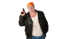 Carefree thug. Holding a gun pointed in the air Royalty Free Stock Photo