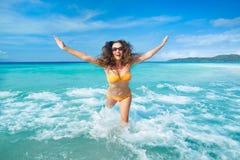 Carefree tourist is enjoying vacation on beach. Stock Photos