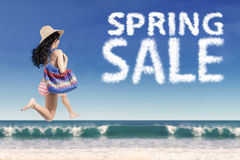 Carefree tourist with spring sale cloud Royalty Free Stock Image
