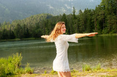 Carefree Twirling. Carefree Girl Twirling at water's edge Stock Photos