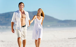 Carefree walking beach couple Stock Photo
