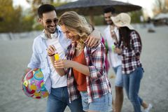Group of young cheerful people bonding to each other and smiling Royalty Free Stock Photos