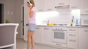 Carefree weekend morning, woman dancing listening to music at home in slow motion stock video footage