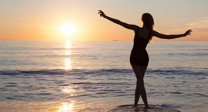 Carefree woman on the beach. royalty free stock photography