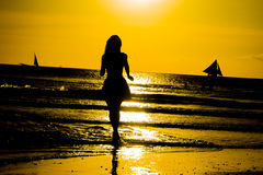 Carefree woman dancing in the sunset on the beach. vacation vita Royalty Free Stock Image