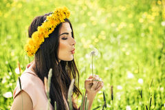 Carefree Woman with a Dandelion on Green Grass. Happy Model Royalty Free Stock Photography