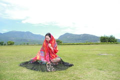 Carefree woman enjoy free time at the foot of montain, healthy living concept, pure happiness and freedom Stock Images