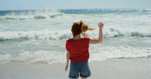 Carefree woman enjoying on the beach 4k stock footage