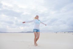 Carefree woman enjoying freedom on beach. Royalty Free Stock Photography
