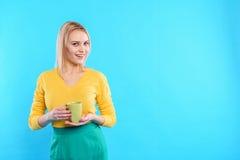 Carefree woman enjoying hot drink Stock Image