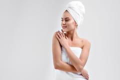 Carefree woman enjoying skincare treatment Stock Photography