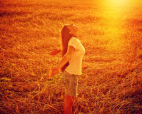 Carefree Woman in field Royalty Free Stock Photography