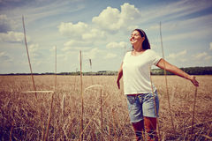 Carefree Woman in field Royalty Free Stock Images