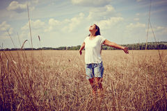 Carefree Woman in field Stock Photo