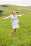 Carefree woman grassland Royalty Free Stock Images