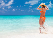 Carefree woman having fun at the beach. vacation vitality healthy living concept. water drops Stock Image