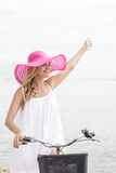 Carefree woman having fun and smiling riding bicycle on the beac Royalty Free Stock Photography