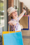 Carefree woman holding shopping bags Stock Image