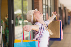 Carefree woman holding shopping bags Royalty Free Stock Images