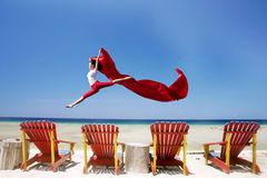 Carefree woman jumping at beach Stock Photography