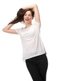 Carefree woman laughing with hand in hair Royalty Free Stock Image