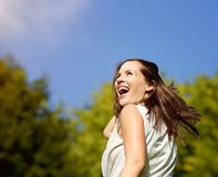 Carefree woman laughing outdoors Stock Photography