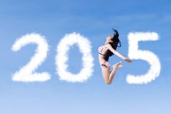 Carefree woman with number 2015 Stock Photos