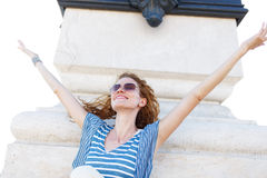 Carefree woman outspread arms outdoor Royalty Free Stock Photo